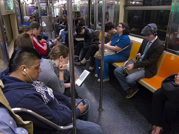 people sitting in seats on subway