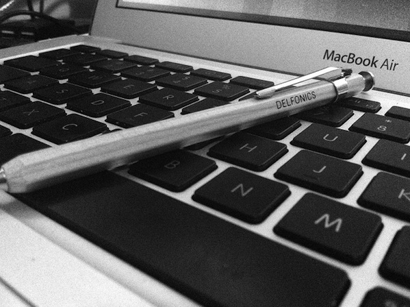 close up of apple macbook laptop keyboard and mechanical pencil