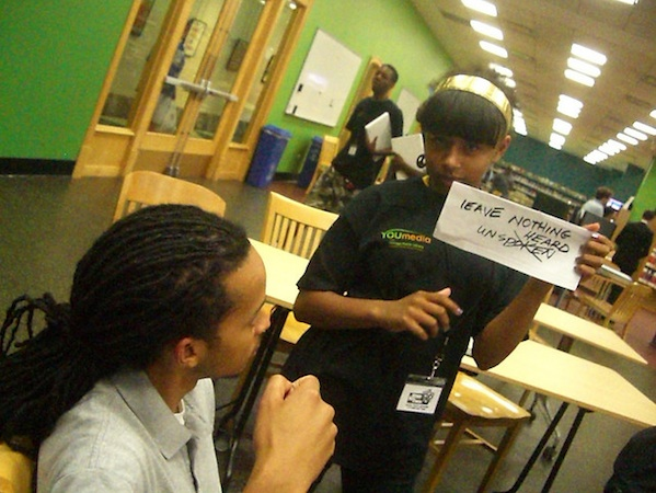 female student working on spoken word at DYN You Media