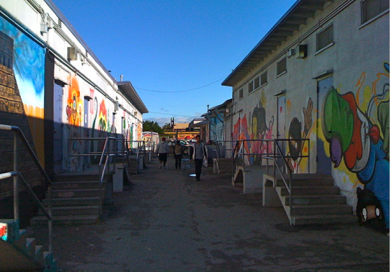 public school classrooms in urban area with graffiti on walls
