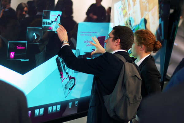 students using multi touch screen on wall