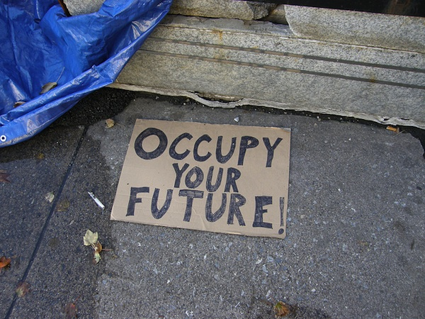 Occupy your future sign on ground during protest rally