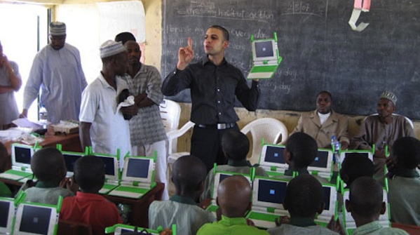 educator teaching students and teachers in Africa how to use computer