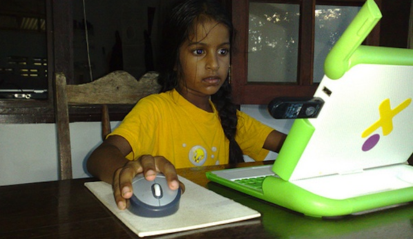 little indian girl working at kids computer at home