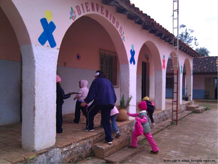 children and adults going into school building in Paraguay