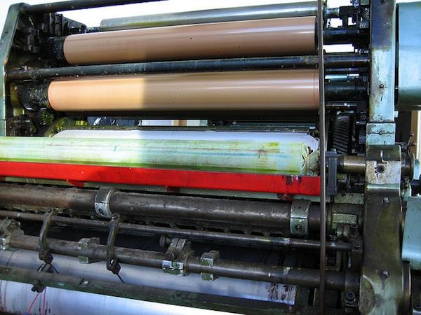 paper rolls on printing press