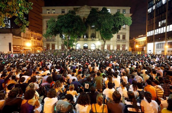 large crowd of protesters rallying in Brazil outside government building
