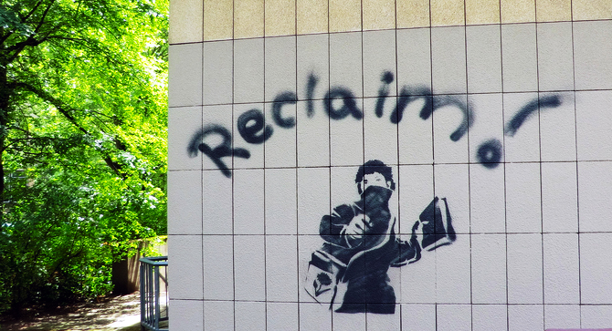 banksy reclaim graffiti tagged on outdoor building wall