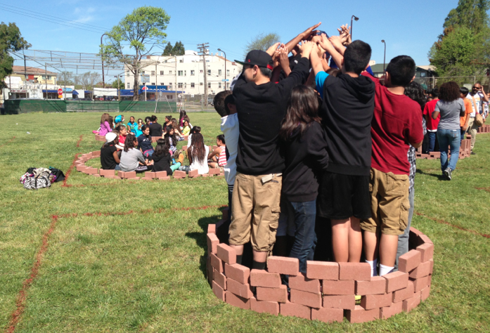 groups of students outside making human fort activity