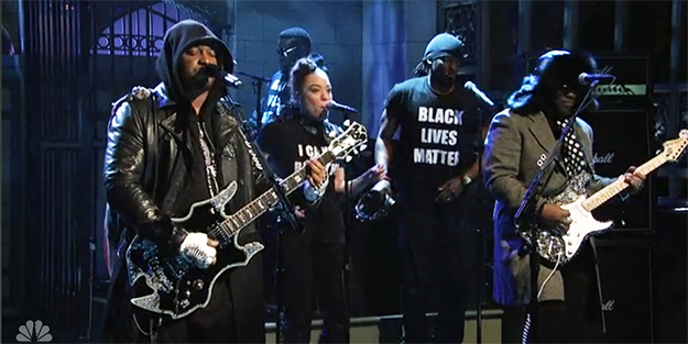 musicians band performing song on SNL with Black lives matter shirts