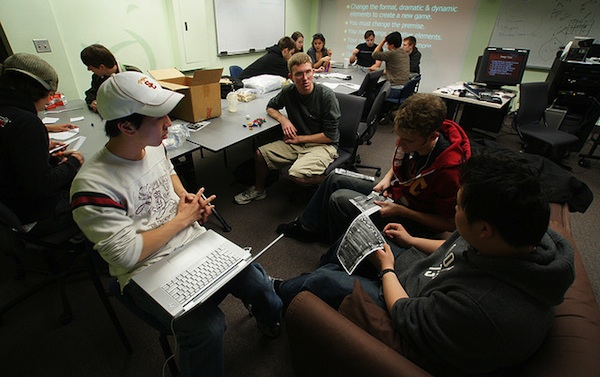 group of teen boys sitting together having classroom collaboration