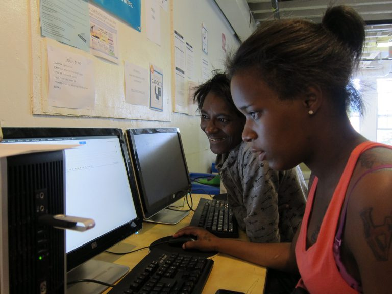 vernell and kanisha working at classroom computer together