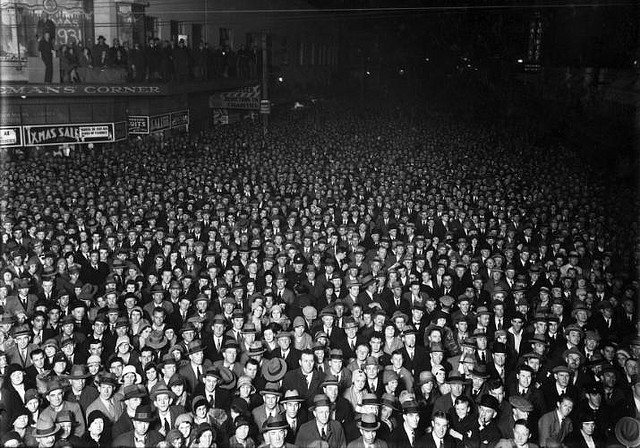 vintage photograph of thousands of men and women gathered in the streets
