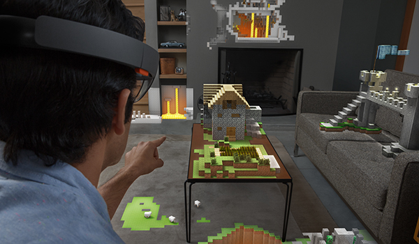 wearables man wearing virtual reality headset pointing at living room covered in minecraft buildings