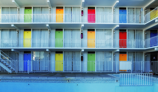 hotel with colorful hotel doors and outdoor pool