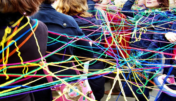 students connected together by colorful strings of yarn